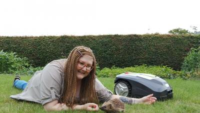 sophie_with_hedgehog_and_robotic_lawn_mower_4